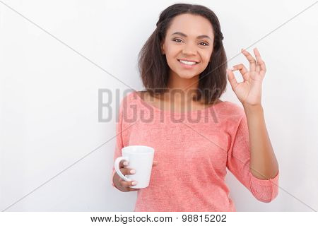 Pretty mulatto girl posing with cup
