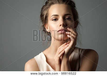 Portrait of a blonde young pretty woman with natural make-up