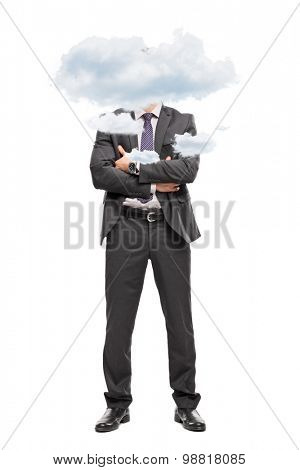 Full length portrait of a businessman in a gray suit with his head up in the clouds isolated on white background