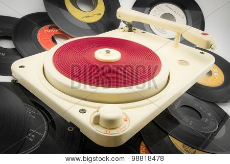 Composition With Vintage Record Player And Old Records