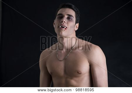 Young Vampire Man Shirtless, Gesturing to Camera