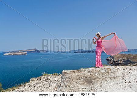 Young Woman Looking At A Beautiful Sea View. Greece, Santorini