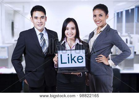 Friendly Businessteam Showing Like On Laptop
