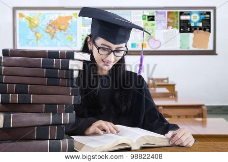 Graduate Student With Mortarboard Reading Book