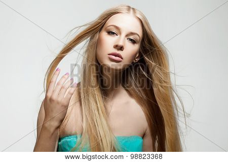 Blonde woman with shiny long hair flying