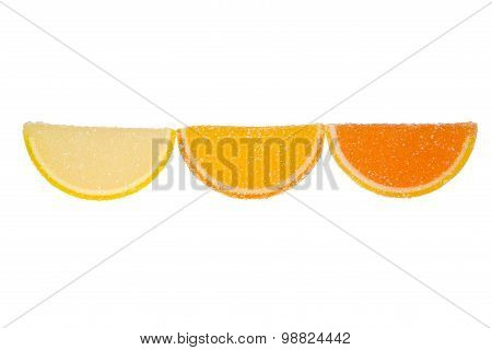 Three Slices Of  Marmalade On A White Background.