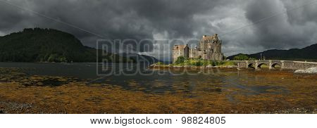 Eilean Donan castle before a storm in Scotland, UK.