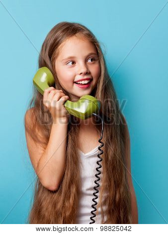 Young Smiling Girl With Green Handset