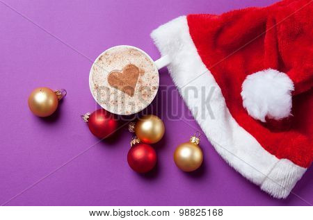 Cup Of Coffee With Heart Shape Near Santas Hat