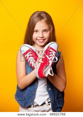 Young Smiling Girl With Red Gumshoes