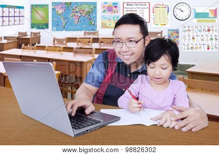 Student Doing School Assignment With Her Teacher