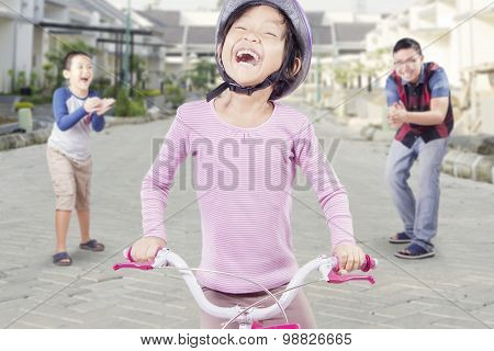Success Girl Riding A Bike
