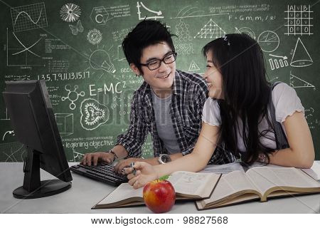 Two Student Laughing In Class 2