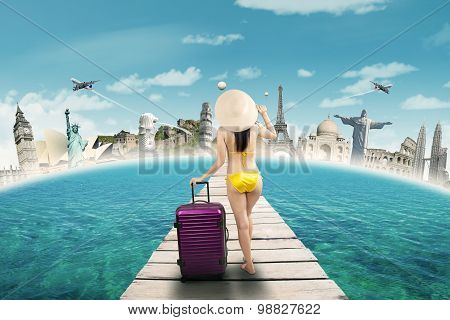 Woman In Swimwear Travelling To The World Monuments