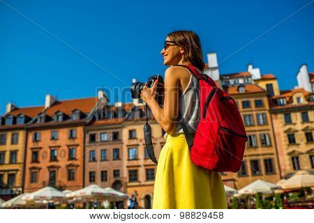 Female traveler in Warsaw's old town
