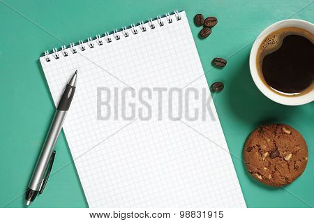 Opened Notepad And Coffee