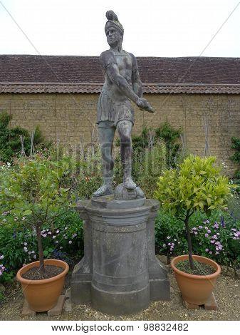Roman Figure Statue Within Tiled Wall Garden