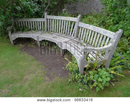 Curved Bench Within Walled Garden