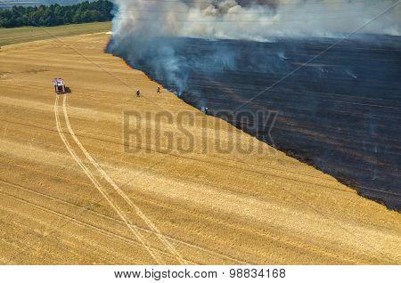 Fireman Truck Working On The Field On Fire
