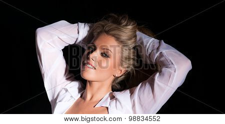 pretty blonde woman with arms behind her head