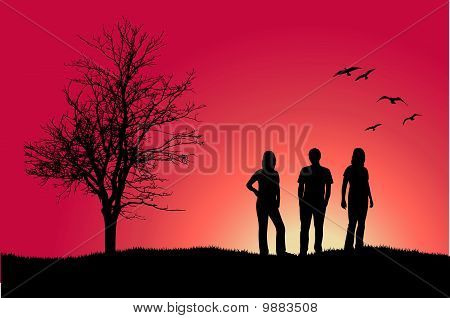 two girls and man standing on hill near bare tree, pink background