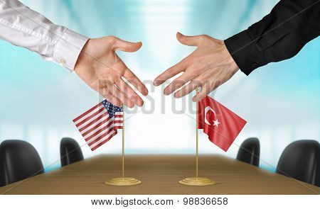 United States and Turkey diplomats agreeing on a deal