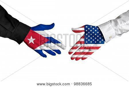 Cuban and American leaders shaking hands on a deal agreement