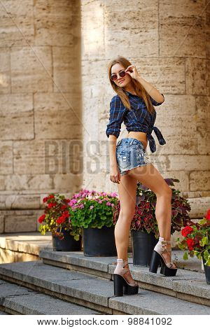 Hipster Girl In Shirt And Jeans Shorts Climb Stairs.