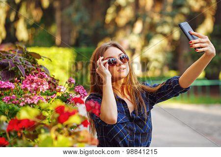 Girl In Sunglasses Making A Self-portrait On Phone. Selfie