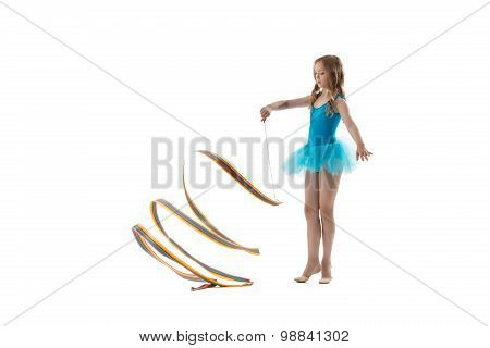 Image of nice little gymnast dancing with ribbon