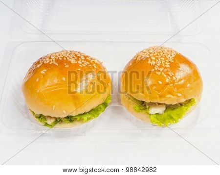 Plastic Take Away Package With Two Piece Of Small Hamburgers