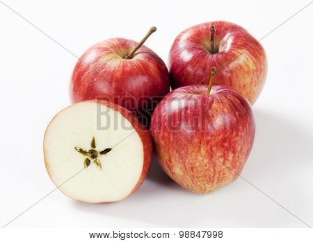 three red apples and half with a star-shaped core