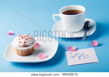 Colorful Muffin On Saucer With Flower Petal