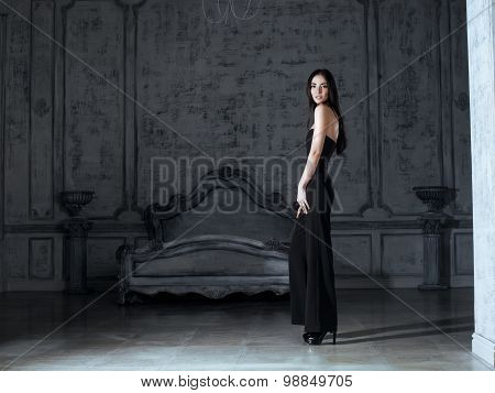 beauty young brunette woman in luxury home interior, fairy bedroom grey stylish bright