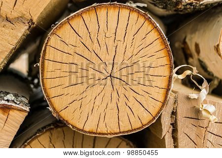 Round piece of wood in the woodpile