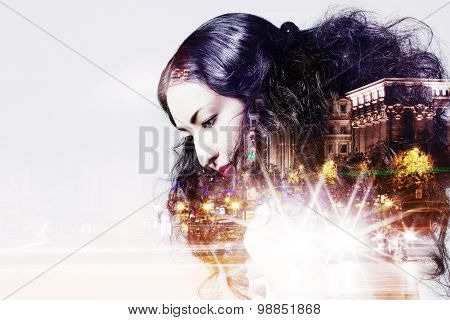 Double exposure of beautiful girl and  city lights at night