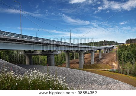 Uncompleted Steel Highway Bridge On Concrete Supports, Crosses Forest Stream