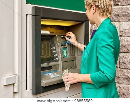 Business Woman Operates Atm