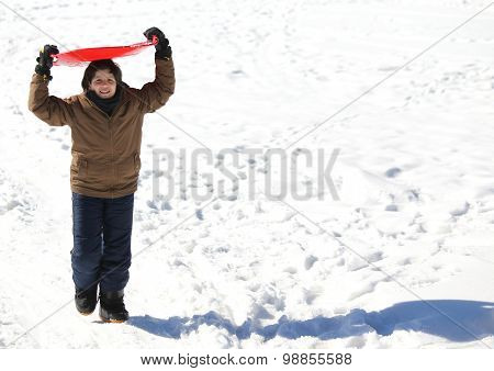 Boy Plays With Sledging In Winter On The White Snow