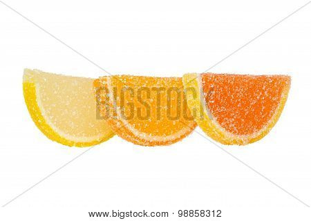 Three Slices Of Colored Marmalade Stand One Behind Another On A White Background.