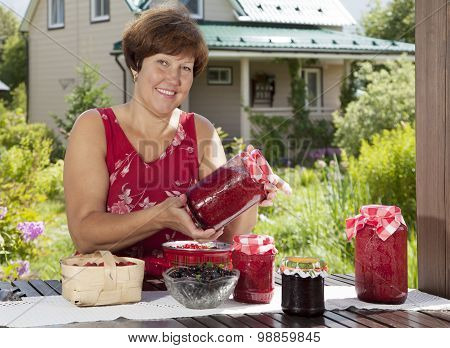 Portrait Of Middle Aged Woman With Fresh Berries