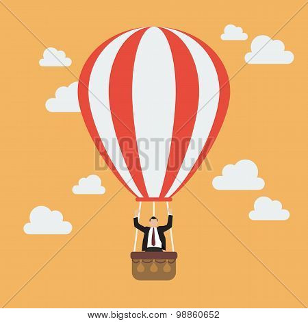 Businessman Celebrating In Hot Air Balloon