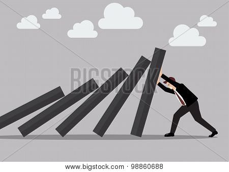 Businessman Pushing Hard Against Falling Deck Of Domino Tiles