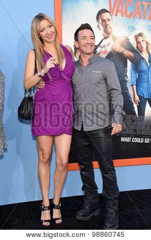 LOS ANGELES - JUL 27:  David Faustino & Lindsay Bronson arrives to the
