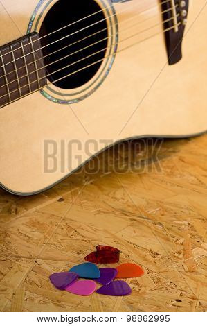 Several Guitar Picks On Osb Wooden Board