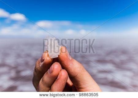 salt of the uyuni salt lake in a male hand