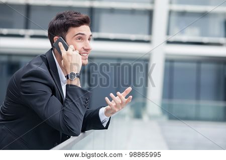 Attractive young businessman is communication on telephone