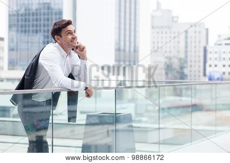 Attractive young man is communicating on the telephone