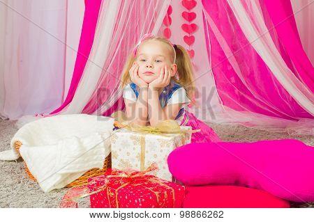 Little girl in a pink skirt