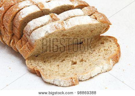 Fresh Sliced Bread Taken Closeup On White Fabric.